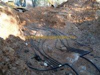 засыпка уложенных труб геотермальной системы